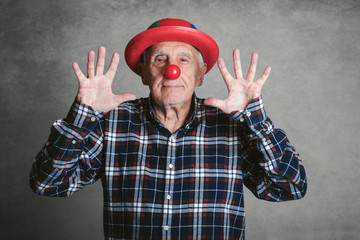funny grandfather with hat and clown nose