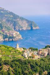 Fototapete - Corniglia - Village of Cinque Terre National Park at Coast of Italy. In the background you can see Manarola. Province of La Spezia, Liguria, in the north of Italy - Travel destination in Europe.