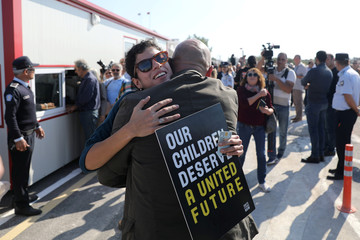 People hug each other at newly opened checkpoint linking the Greek and Turkish Cypriot communities in Dherinia