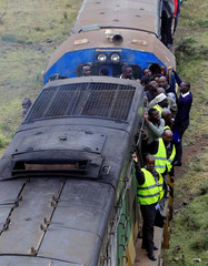 Passengers ride on an overloaded Nairobi Commuter Rail Service's (NCRS) commuter train traveling from the Mutindwa station in during a strike by the Federation of Public Transport operators in Nairobi