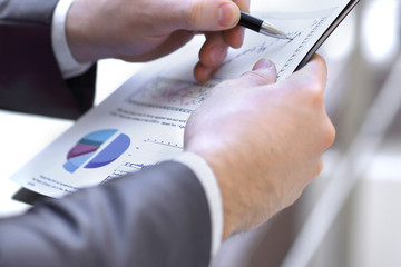 close up.financial report in the hands of a businessman.