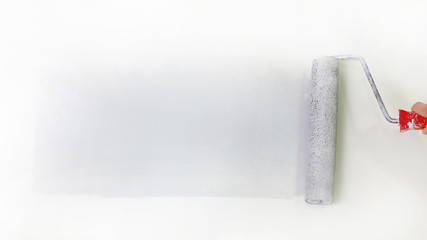 paint roller painting a stripe on a white background