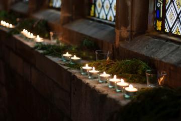 Tealights, lit in a church