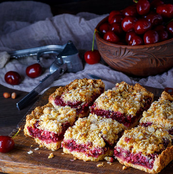 square pieces of cake crumble on brown wooden board