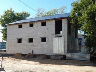 Construction of a brick house. Two-storey country cottage. New real estate.