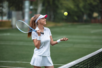 Young smiling girl playing tennis