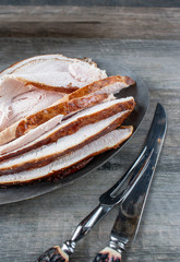 Turkey slices of white meat on platter with knife and fork top view