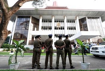 Sri Lankan Police stand guard in front of the Supreme Court in Colombo