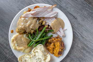 Thanksgiving or Christmas meal plate with turkey flat lay