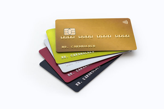 Stack of multicolored credit cards on white background