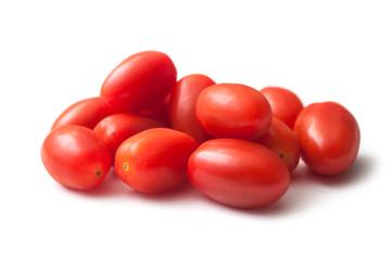 closeup of mini organic tomatoes roma on white background Fototapete