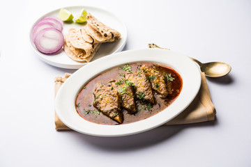 Patodi Rassa Bhaji or patwadi Sabji, a popular Maharashtrian spicy recipe served with Chapati and salad. Selective focus