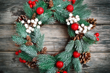 Merry Christmas and happy New year. Christmas decorative wreath on wooden background. Background with copy space. Horizontal. Selective focus.