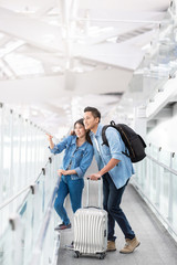 Asian couple traveler with luggage at airport