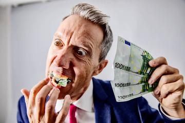 Euro, Euroschine Mann isst Geld