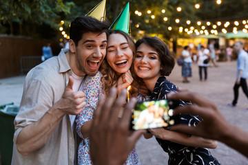 Group of happy multhiethnic friends celebrating
