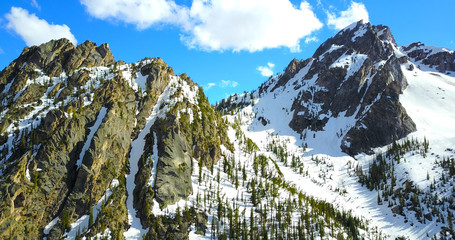 Sawtooth Mountains, Idaho, USA - Jagged Snowy Peaks With Pine Trees On The Slopes