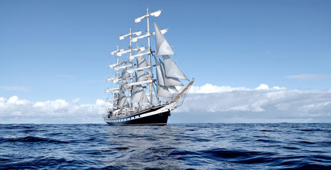 Fototapeten Schiff Sailing ship under white sails at the regatta