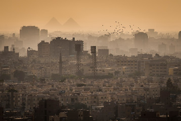 Cityscape of Cairo, with the Great Pyramids of Gizeh in the Background