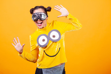 Beautiful young woman wearing funny minion pullover. Funny moment