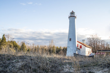 Remote Michigan Lighthouse Beach Landscape. Sturgeon Point Lighthouse on the shores of Lake Huron in the Lower Peninsula of Michigan.
