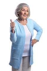 Portrait of beautiful senior woman showing thumb up