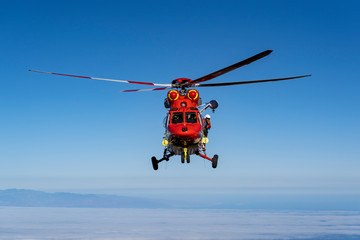 Mountain Rescue Helicopter is called by Altavista Refuge staff to pick up an a hiker who suffers from altitude sickness above 3000m