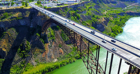 Perrine Bridge, Twin Falls, Idaho, USA - Aerial View Over River Canyon With Cars Driving On Road