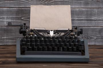 image of retro typewriter on wooden background. writer, journalist.