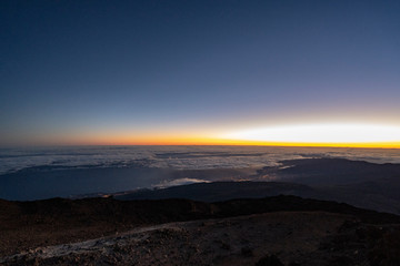 Sun is rising over Canary Islands, seen  from near the summit of Teide Mountain, Tenerife, Canary Islands, Spain