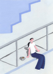 二階でリラックスする女性