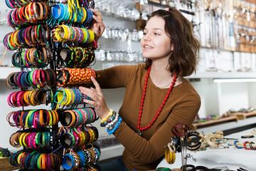 Girl seller offering colored bracelets