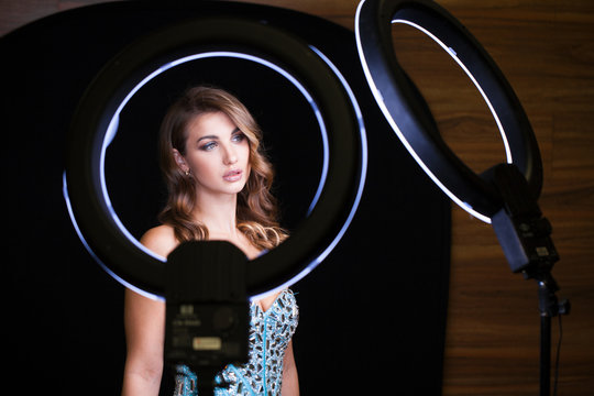 Young woman with ring flash effect. Round LED Circle Lamp
