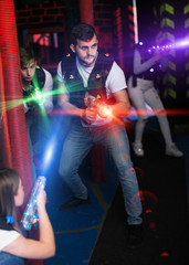 Guy in colored beams during laser tag game