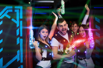 Friends with laser guns in colored beams