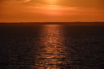 red saturated colors in sunset over the sea
