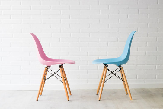 pair of chairs in pink and blue, equality concept