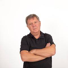 mature man in black shirt looking cool