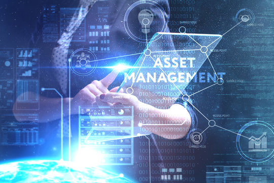 The concept of business, technology, the Internet and the network. A young entrepreneur working on a virtual screen of the future and sees the inscription: Asset management