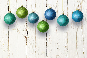 Christmas decoration over wooden background. Christmas balls.