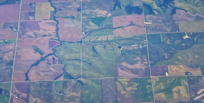 Aerial view of crop circles and squares over midwest states on flight over Colorado, Kansas, Missouri, Illinois, Indiana, Ohio and West Virginia during autumn. Grand sweeping views of agriculture land