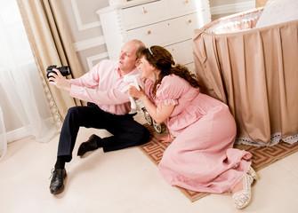 A man takes a selfie with a pregnant woman