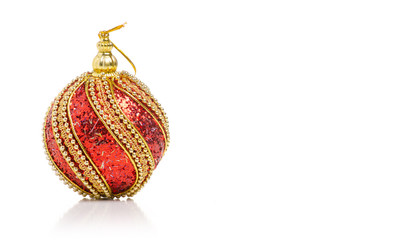 Christmas toys red golden ball on a white background isolation