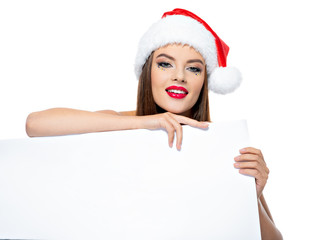 Portrait of a  woman in a santa hat with banner.
