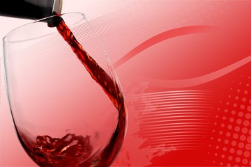 Pouring Red Wine into a Glass - Isolated