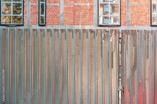 Corrugated metal fence on construction site
