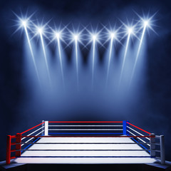 Boxing ring lit by spotlights, Fight night event
