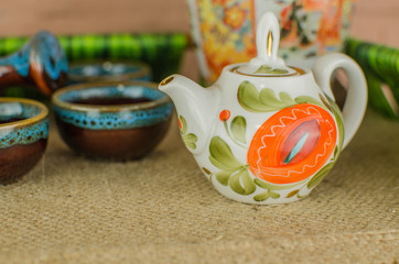 Chinese tea ceremony with Anchnag on wooden background
