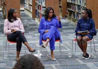 Former first lady Michelle Obama begins her book tour with a stop at the Whitney M. Young Magnet High School in Chicago