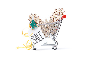 Photo of cart with wooden snowflakes, Christmas tree, postcard, ribbon